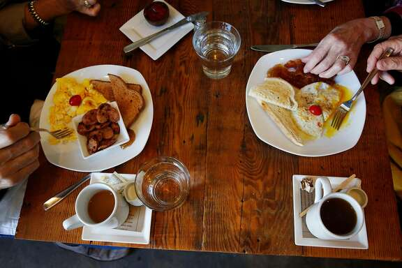 "From left, going clockwise, Jack and Tamara Papazian, Sandra and Martin Schwartz eat breakfast as they chat with each other at Element Jan. 24, 2015 in Sutter Creek, Calif. The breakfast and lunch restaurant is located at the Hanford House Inn. The group has been visiting the Amador County area for wine tasting for 6 or 7 years. ""It's like Napa used to be 40 years ago,"" said Sandra Schwartz."