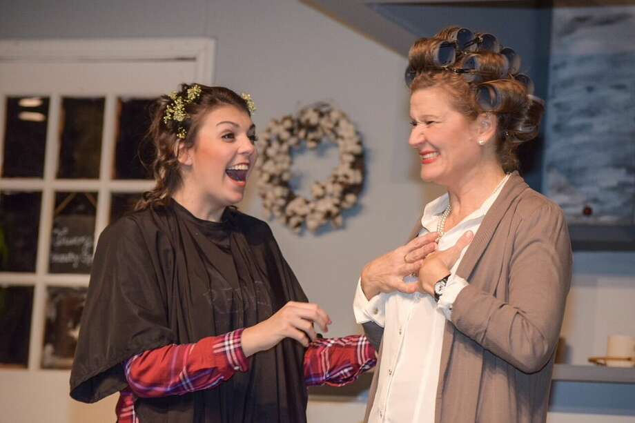 "Shelby (Lizzie Camp) and mother M'Lynn (Cindy Siple in curlers) share a carefree interlude at Truvy's beauty salon in ""Steel Magnolias."" The comedy-drama continues on weekends through Feb. 11 in downtown Conroe's Owen Theatre, www.OwenTheatre.com."
