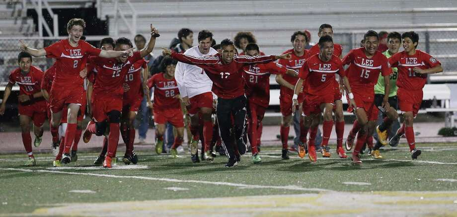 The Lee High School boys soccer team reacts after their tie game at nil against Reagan to become district champions and are headed to the playoffs for the first time since 2011. (Kin Man Hui/San Antonio Express-News) Photo: Kin Man Hui, Staff / San Antonio Express-News / ©2015 San Antonio Express-News