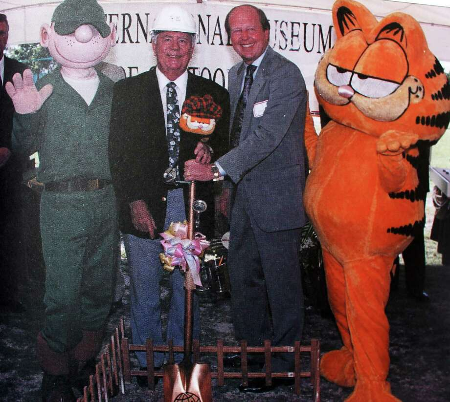 """Mort Walker, second from left, Jim Davis, third from left, and their two most famous creations, Walker's """"Beetle Bailey"""" and Davis' """"Garfield,"""" break ground to start construction of the International Museum of Cartoon Art in Boca Raton, Fla., in the early 1990s. Walker died Saturday, Nov. 27, 2018 at age 94. Photo: Contributed Photo / Stamford Advocate  contributed"""