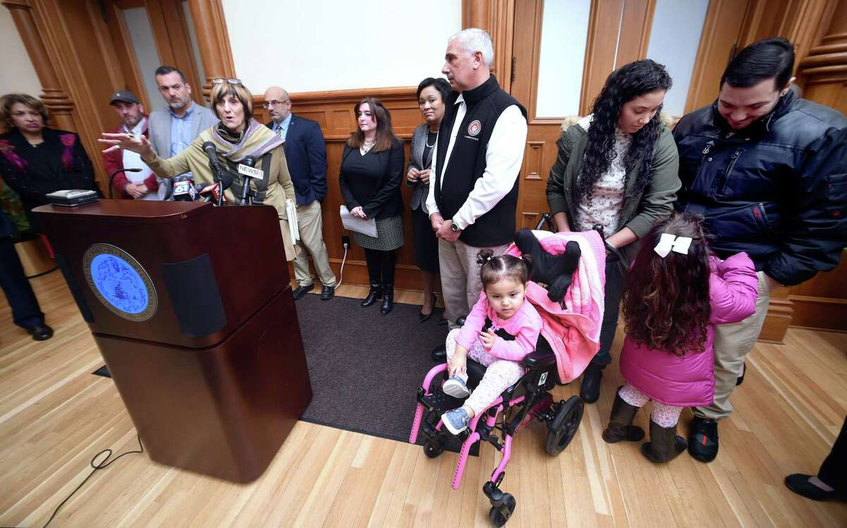 U.S. Rep. Rosa DeLauro speaks at a news conference at City Hall in New Haven Monday . At right is Karla Pantoja with her husband, Edwin Hernandez, and daughters Miia Hernandez, 2, and Zoe Hernandez, 4. They moved to the area from Puerto Rico after hurricane Maria.