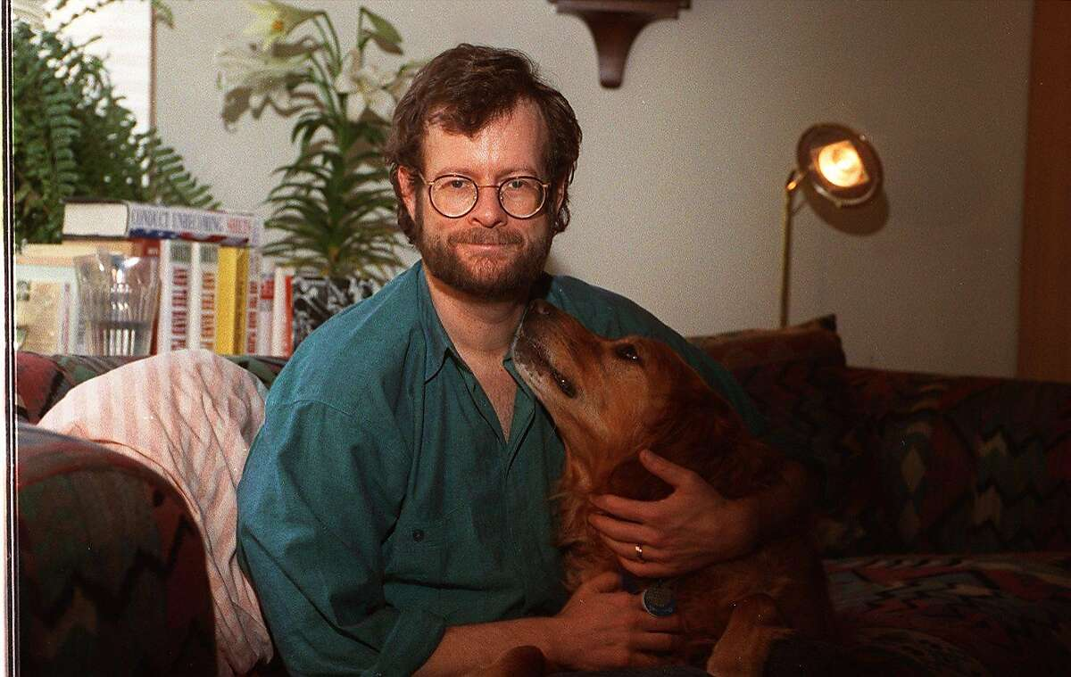 CHRONICLE 02/18/94 // RANDY SHILTS, in a 1993 photo, with his dog Dash