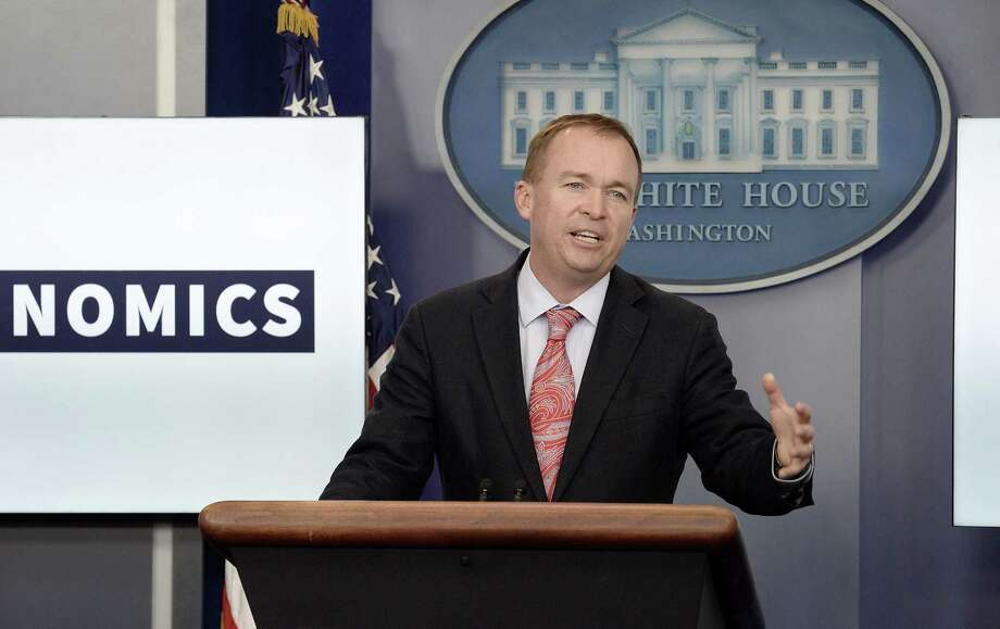 Mick Mulvaney, director of the Consumer Financial Protection Bureau, is trying to dismantle regulations protecting borrowers from payday lenders. Photo: Olivier Douliery /TNS / Abaca Press