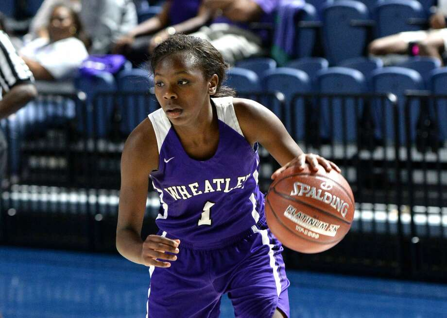 Telisha Brown (1) of Wheatley drives toward the hoop during the third quarter of the championship game in the Houston ISD Varsity Girls Tournament between the Kinkaid Falcons and the Wheatley Wildcats on Saturday December 2, 2017 at Delmar Fieldhouse, Houston, TX. Photo: Craig Moseley/Houston Chronicle