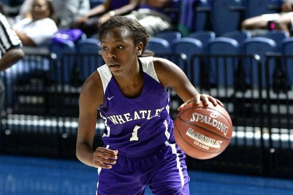 Telisha Brown (1) of Wheatley drives toward the hoop during the third quarter of the championship game in the Houston ISD Varsity Girls Tournament between the Kinkaid Falcons and the Wheatley Wildcats on Saturday December 2, 2017 at Delmar Fieldhouse, Houston, TX.