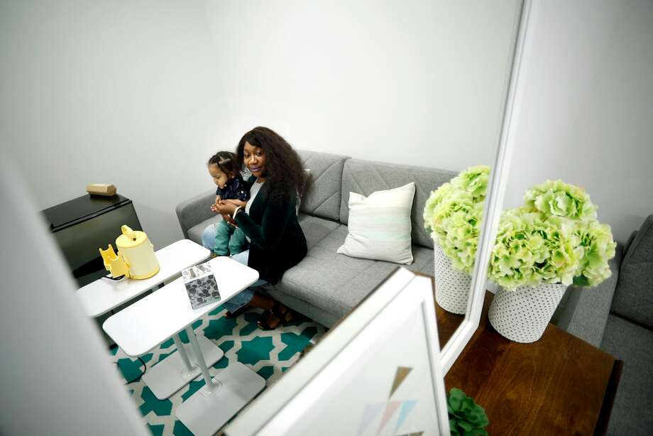 Ruth Arevalo, who stopped nursing as her office had no private space, sits with son Josiah in a lactation room at Stitch Fix. Photo: Michael Macor, The Chronicle