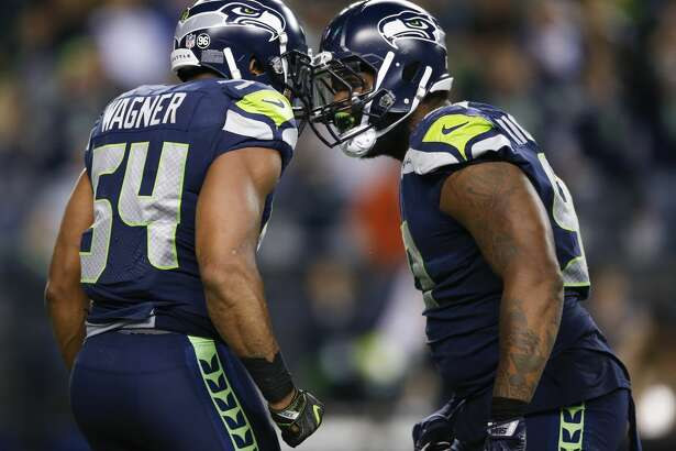 SEATTLE, WA - OCTOBER 1: Middle linebacker Bobby Wagner #54 of the Seattle Seahawks celebrates his fumble recovery for a touchdown with defensive tackle Sheldon Richardson #91in the fourth quarter of the game at CenturyLink Field on October 1, 2017 in Seattle, Washington. (Photo by Otto Greule Jr/Getty Images)