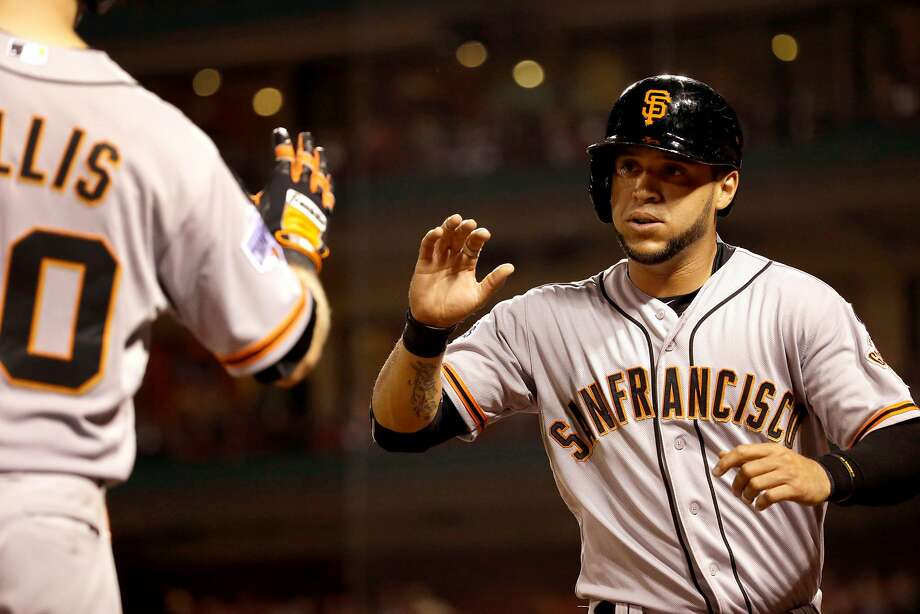 San Francisco Giants' Gregor Blanco, right, is congratulated by teammate Ryan Lollis after during the sixth inning of a baseball game against the St. Louis Cardinals Tuesday, Aug. 18, 2015, in St. Louis. (AP Photo/Jeff Roberson) Photo: Jeff Roberson, Associated Press