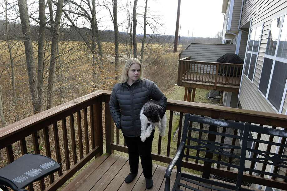 Melissa Rinaldi, a resident of Lexington Meadows Condominiums in Bethel, talks about Eversource's plans to install a poll near to her home, in the marshland behind her, Monday, January 29, 2018. Photo: Carol Kaliff / Hearst Connecticut Media / The News-Times
