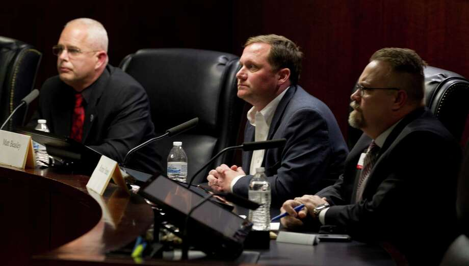 Candidates for Montgomery County Precinct 3 Justice of the Peace, Daniel Zientek, Matt Beasley and Ronnie Yeates are seen next during a Montgomery County Eagle Forum, Thursday, Jan. 25, 2018, in Shenandoah. Photo: Jason Fochtman, Staff Photographer / © 2018 Houston Chronicle