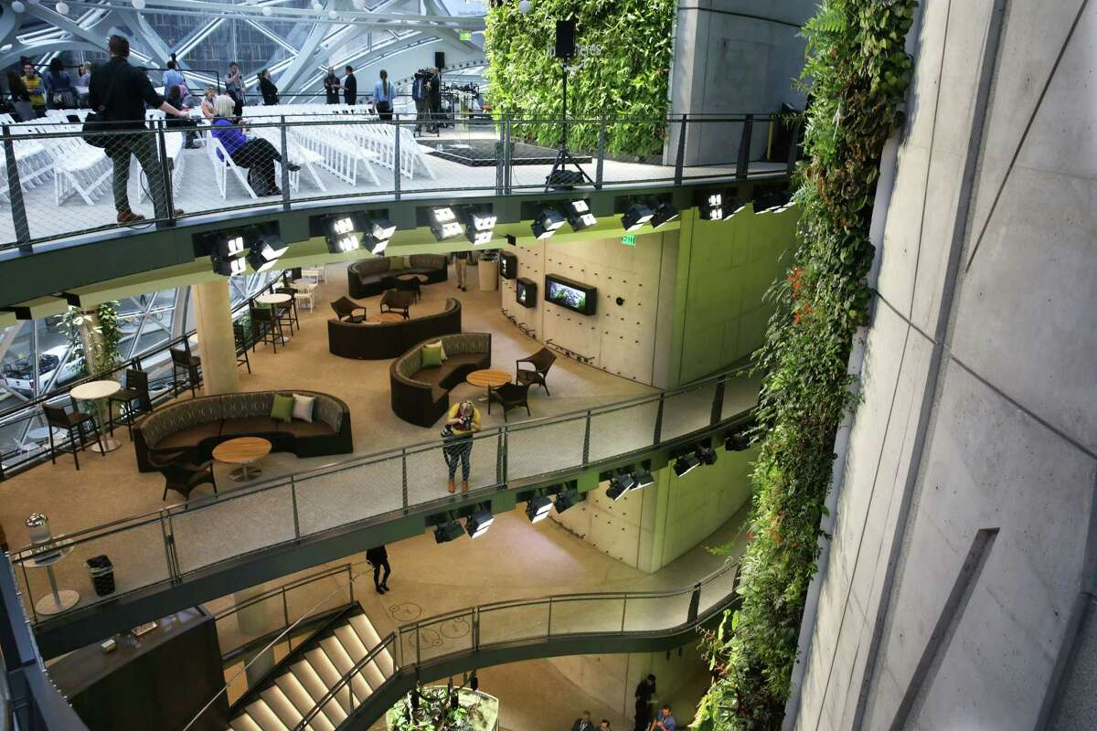 Guests explore the Amazon Spheres during an opening day unveiling event, Monday morning, Jan. 29, 2018. The Spheres are an innovative workplace filled with more than 40,000 plants from around the world, that will be available to Amazon employees beginning this week. The four main floors include a cafe and coffee bar.