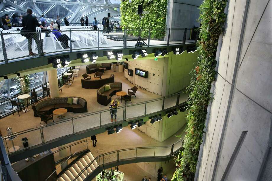 Guests explore the Amazon Spheres during an opening day unveiling event, Monday morning, Jan. 29, 2018. The Spheres are an innovative workplace filled with more than 40,000 plants from around the world, that will be available to Amazon employees beginning this week. The four main floors include a cafe and coffee bar. Photo: GENNA MARTIN, SEATTLEPI.COM / SEATTLEPI.COM