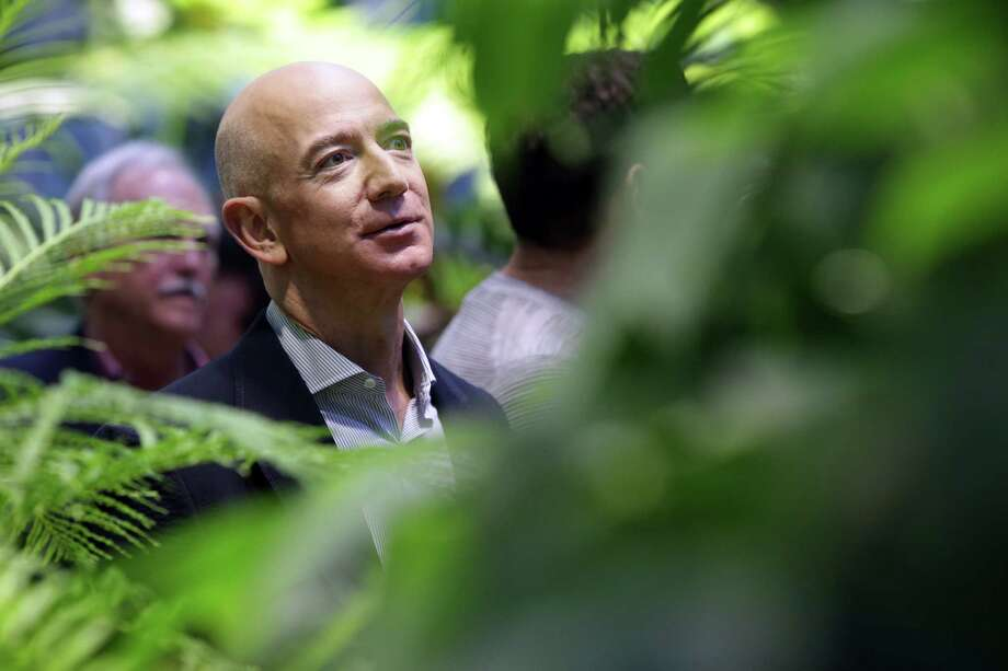 Amazon CEO Jeff Bezos tours The Spheres during an opening day unveiling event, Monday morning, Jan. 29, 2018. The Spheres are an innovative workplace filled with more than 40,000 plants from around the world, that will be available to Amazon employees beginning this week. Photo: GENNA MARTIN, SEATTLEPI.COM / SEATTLEPI.COM