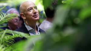 Amazon CEO Jeff Bezos tours The Spheres during an opening day unveiling event, Monday morning, Jan. 29, 2018. The Spheres are an innovative workplace filled with more than 40,000 plants from around the world, that will be available to Amazon employees beginning this week.