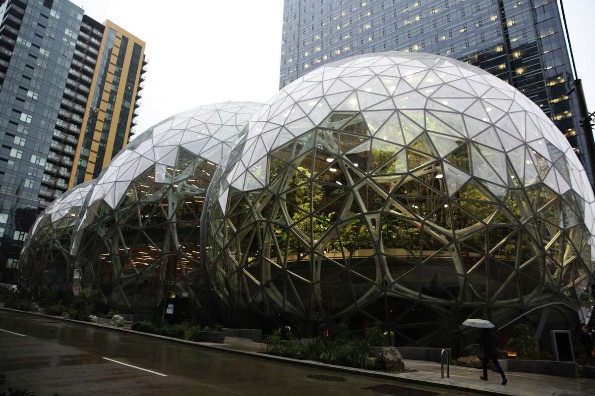 Guests explore the Amazon Spheres during an opening day unveiling event, Monday morning, Jan. 29, 2018.