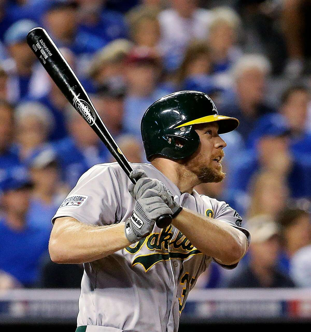 Oakland Athletics' Brandon Moss watches his three-run home run during the sixth inning of the AL wild-card playoff baseball game against the Kansas City Royals on Tuesday, Sept. 30, 2014, in Kansas City, Mo. (AP Photo/Charlie Riedel)