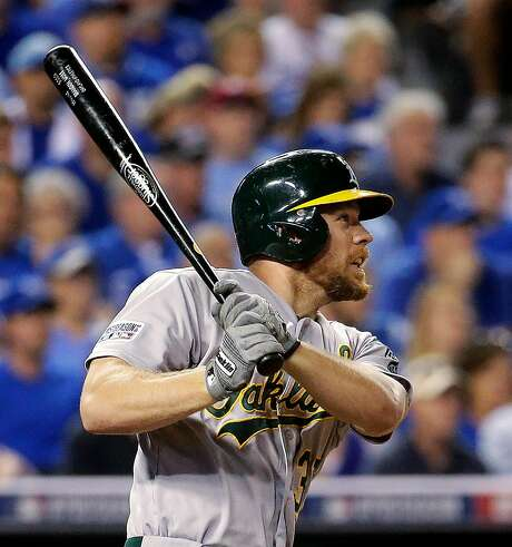 Brandon Moss homered twice in the A's 2014 wild-card loss. Photo: Charlie Riedel, Associated Press