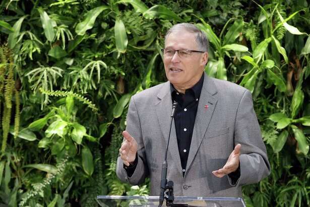 Governor Jay Inslee speaks during an opening day event for The Amazon Spheres, Monday morning, Jan. 29, 2018. The Spheres are an innovative workplace filled with more than 40,000 plants from around the world, that will be available to Amazon employees beginning this week.