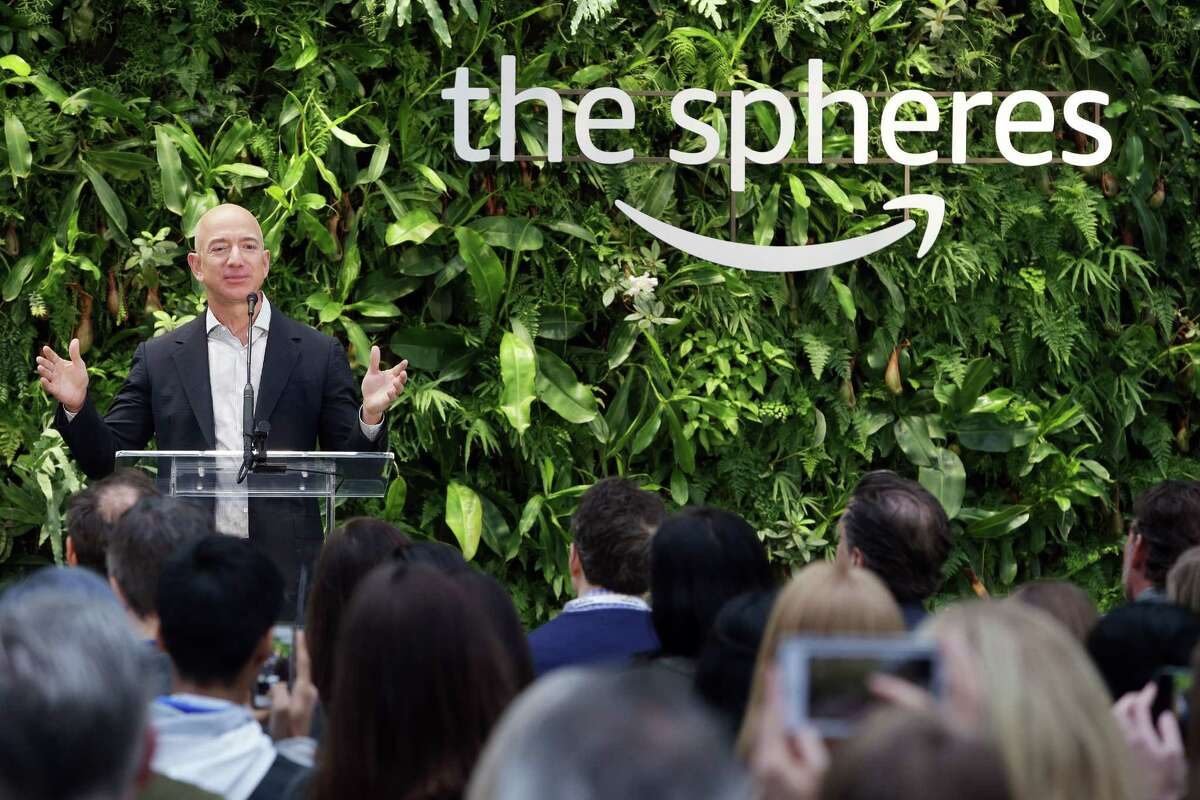 Amazon CEO Jeff Bezos speaks during an opening day event The Spheres, Monday morning, Jan. 29, 2018. The Spheres are an innovative workplace filled with more than 40,000 plants from around the world, that will be available to Amazon employees beginning this week.