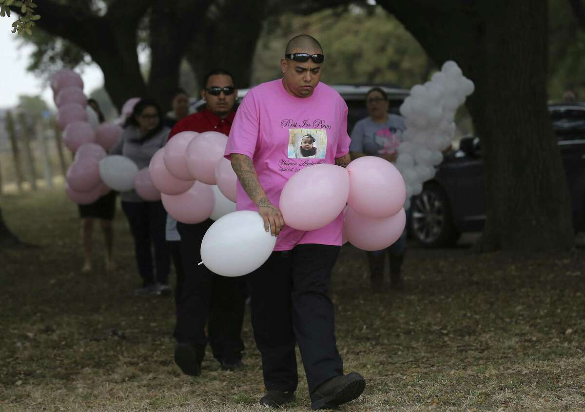 George Estrada, godfather to Heaven Abcdey Salinas, carries a chain of balloons to be released during a funeral service for Salinas, an 8-month-old girl who died from sudden infant death syndrome. The balloons were provided at no cost by the nonprofit Benjamin's Right Hand, which San Antonio mother Jessica Craven formed to help families mourning the death of a child ranging from infancy up to 12 years old. Craven knows the pain of losing a child - her 5-month-old son, Benjamin, accidentally died from probable asphyxia in 2015 while he was being cared for by a sitter.
