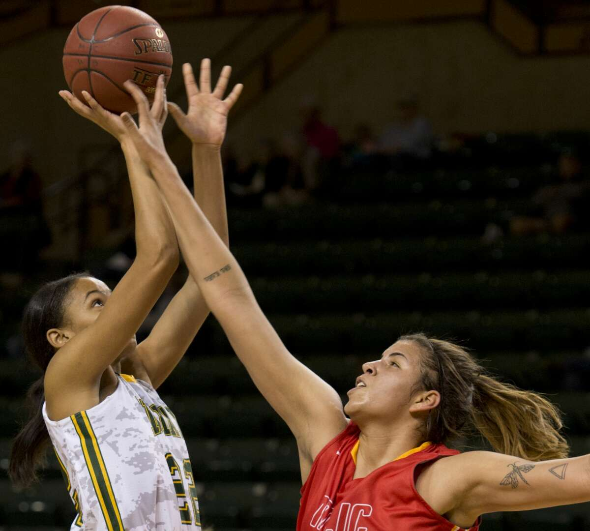 Midland College's Paige Robinson puts up a shot as New Mexico Junior College's Amanda Maqueia defends 01/29/18 at the Chaparral Center. Tim Fischer/Reporter-Telegram