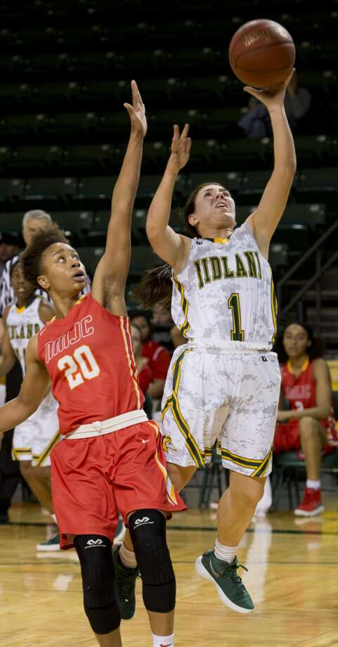 Midland College's Bethany Theodore drives to the basket past New Mexico Junior College's Tatiana Wright 01/29/18 at the Chaparral Center. Tim Fischer/Reporter-Telegram Photo: Tim Fischer/Midland Reporter-Telegram