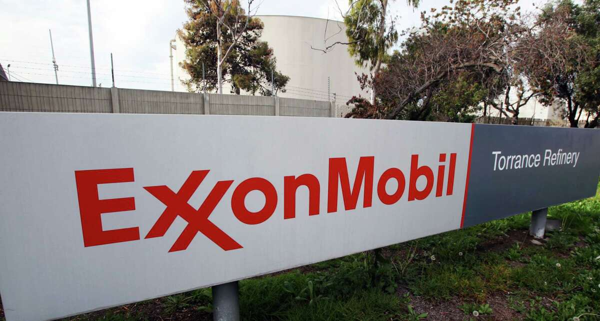 This Jan. 30, 2012, file photo, shows the sign for the ExxonMobil Torerance Refinery in Torrance, Calif.  Exxon has apparently agreed to start reporting when it spills plastic pellets, a major source of ocean pollution. NEXT: See photos from an project to clean up plastics from the ocean.