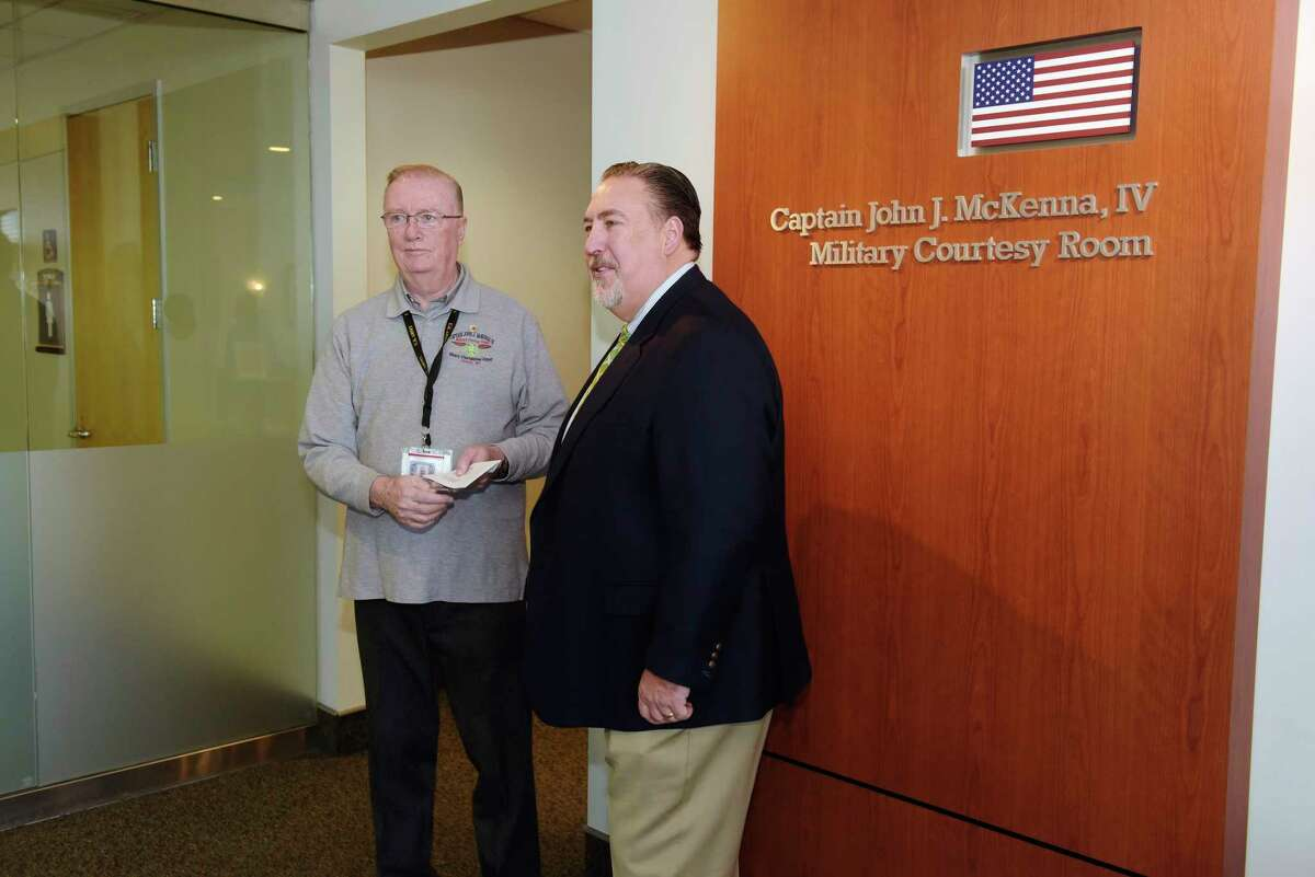 John McKenna, III, left, the father of John McKenna, IV, and Todd Helfrich, president and CEO of The Eastern Contractors Association talk with the media during an event where a $1,000 donation was made by the members of the Contractors Association to help fund the John J. McKenna IV Military Courtesy Room at the Albany International Airport on Monday, Jan. 29, 2018, in Colonie, N.Y. (Paul Buckowski/Times Union)