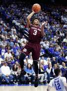 Texas A&M is hoping that Admon Gilder, left, and Duane Wilson can keep playing despite knee injuries that have limited their effectiveness recently.