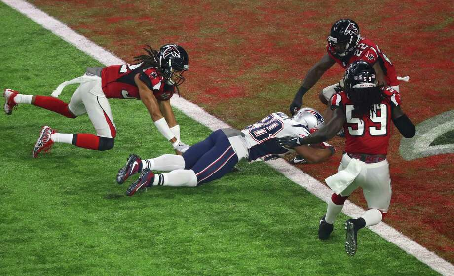 Last year at NRG Stadium, James White capped a comeback from a 28-3 deficit by diving for the winning TD in overtime. Photo: Michael Ciaglo, Staff / Michael Ciaglo