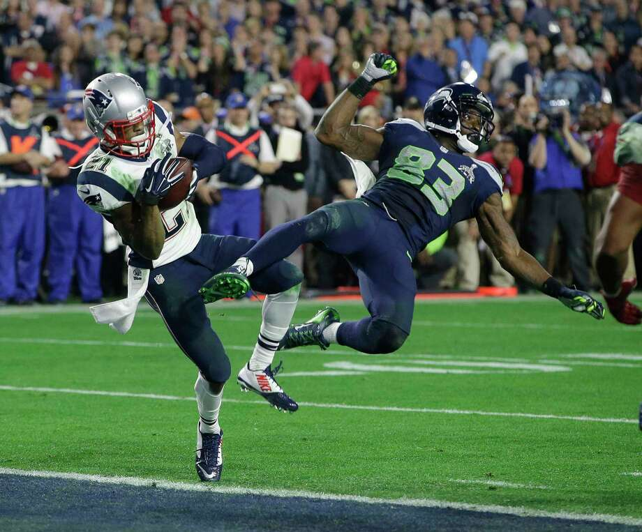 New England Patriots strong safety Malcolm Butler (21) intercepts a pass intended for Seattle Seahawks wide receiver Ricardo Lockette (83) during the second half of NFL Super Bowl XLIX football game Sunday, Feb. 1, 2015, in Glendale, Ariz. (AP Photo/Kathy Willens) Photo: Kathy Willens, STF / AP