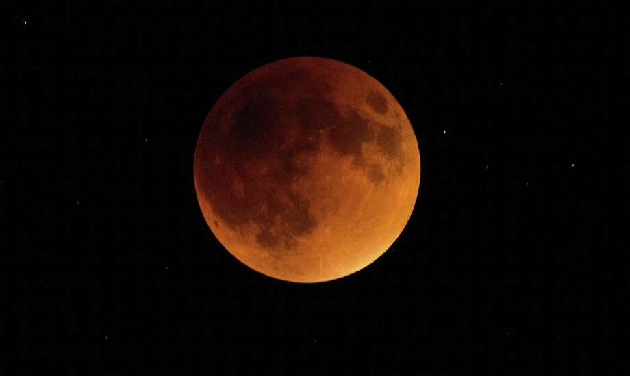 A lunar eclipse in 2015. The moon will once again be a special sight on Jan. 31, 2018. (John Sleezer/Kansas City Star/TNS) Photo: JOHN SLEEZER, MBR / TNS / Kansas City Star