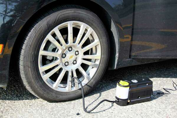 A handout photo of the tire inflator supplied with the 2011 Chevrolet Cruze Eco. Nearly a third of the 2017 model cars offered in the U.S. do not come outfitted with a save-the-day spare as standard equipment, according to a recent study by AAA. (General Motors via The New York Times) -- NO SALES; FOR EDITORIAL USE ONLY WITH STORY SLUGGED AUTOS SPARE TIRE  BY MAYERSOHN FOR NOV. 9, 2017. ALL OTHER USE PROHIBITED.