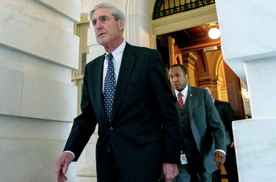 FILE - In this June 21, 2017, file photo, former FBI Director Robert Mueller, the special counsel probing Russian interference in the 2016 election, departs Capitol Hill following a closed door meeting in Washington. (AP Photo/Andrew Harnik, File) Photo: Andrew Harnik, STF / Associated Press