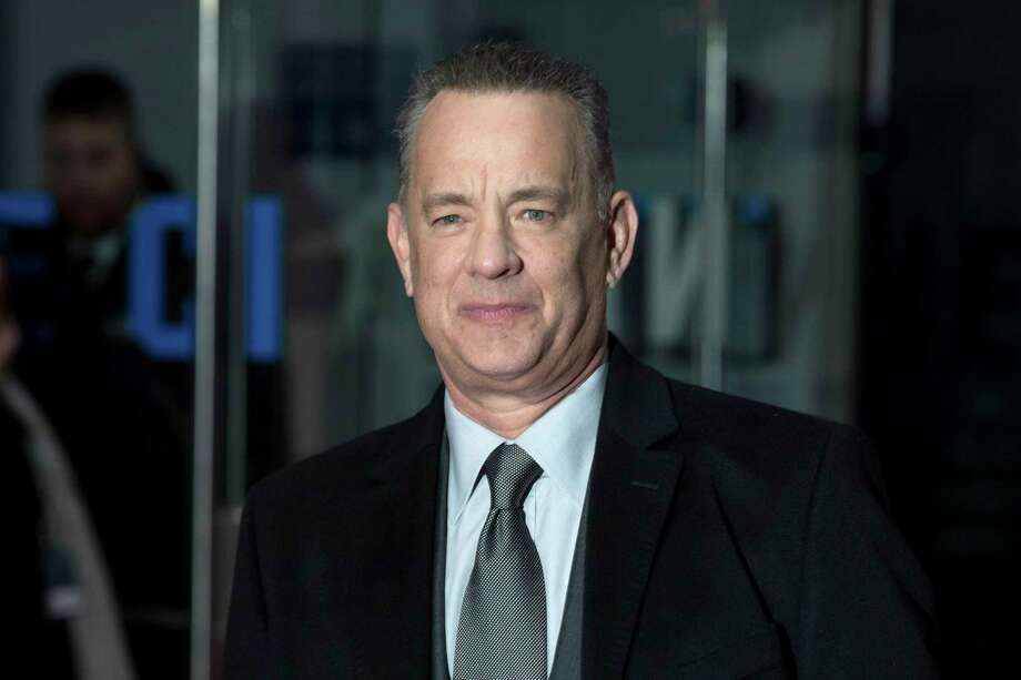 """FILE - In this Jan. 10, 2018 file photo, actor Tom Hanks poses for photographers at the premiere of """"The Post"""" in London. A photo that Hanks posted from the Bay Area took off on social media as locals welcomed the actor """"home."""" News recently broke that Hanks will star as Mr. Rogers in the upcoming biopic ,""""""""You Are My Friend."""""""" Photo: Grant Pollard / Invision"""