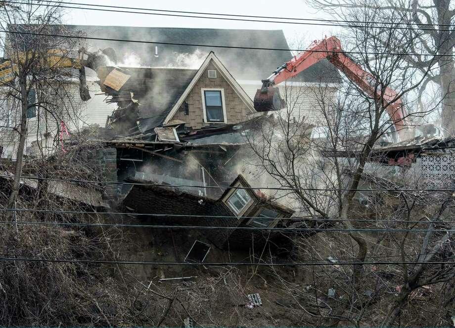 Demolition begins on the homes Barney Street after a weekend mudslide Monday, Jan. 29, 2018 in Schenectady, N.Y.  (Skip Dickstein/Times Union) Photo: SKIP DICKSTEIN