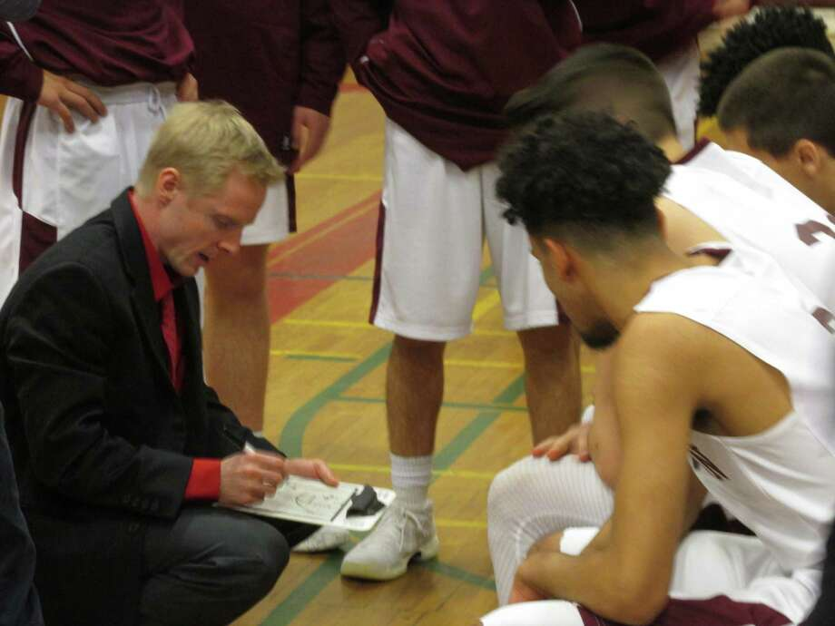Torrington coach Eric Gamari had his Raiders back to playing their roles in a win over SWC opponent Newtown Monday night at Torrington High School. Photo: Peter Wallace / For Hearst Connecticut Media