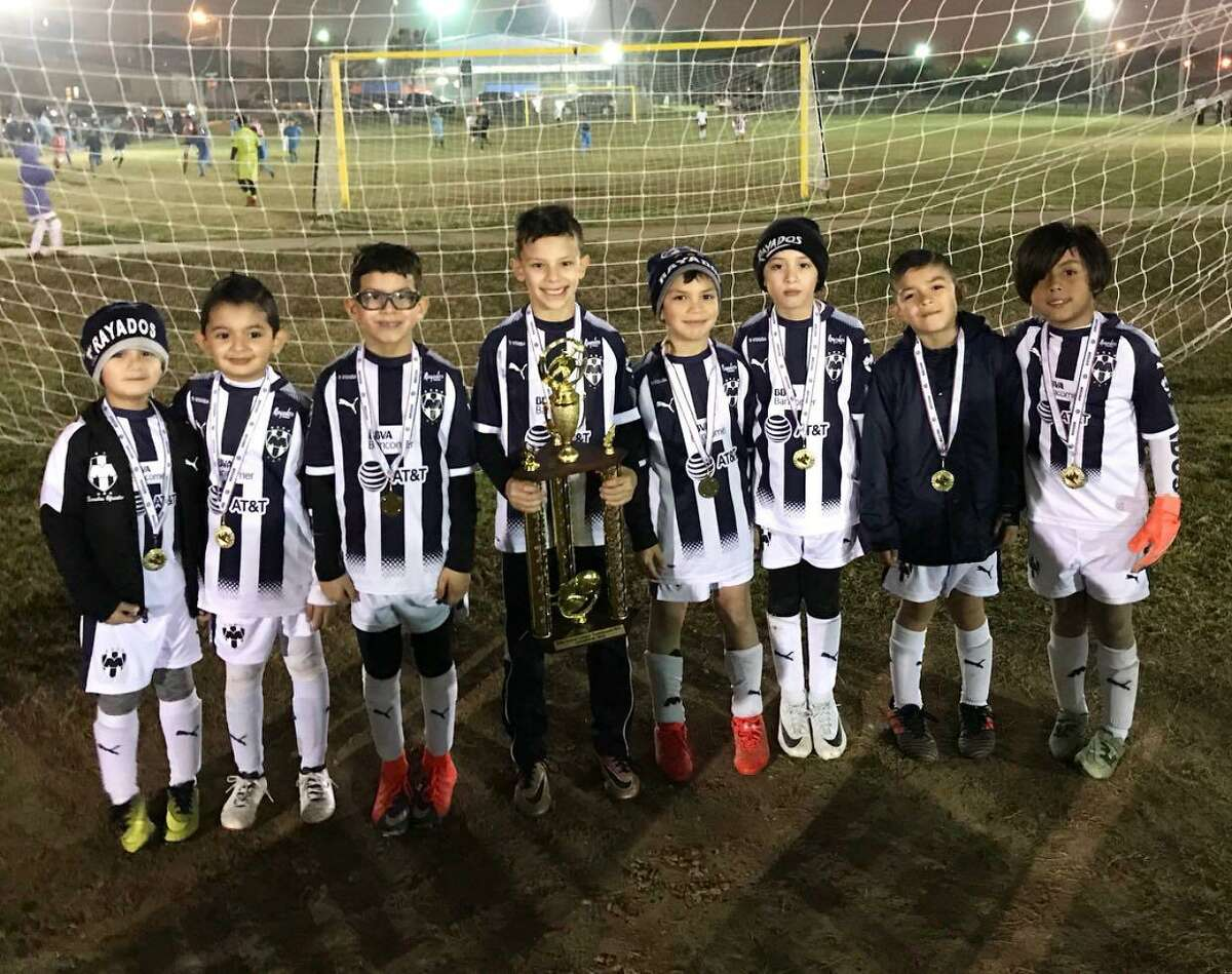 The 2010 Rayados blue team won back-to-back season championships in the 7 Flags Elite soccer league. Pictured from left are Mundo, Damian, Dallas, Mau, Joaquin, Angel Del Bosque, Angel Pruneda and Luis.