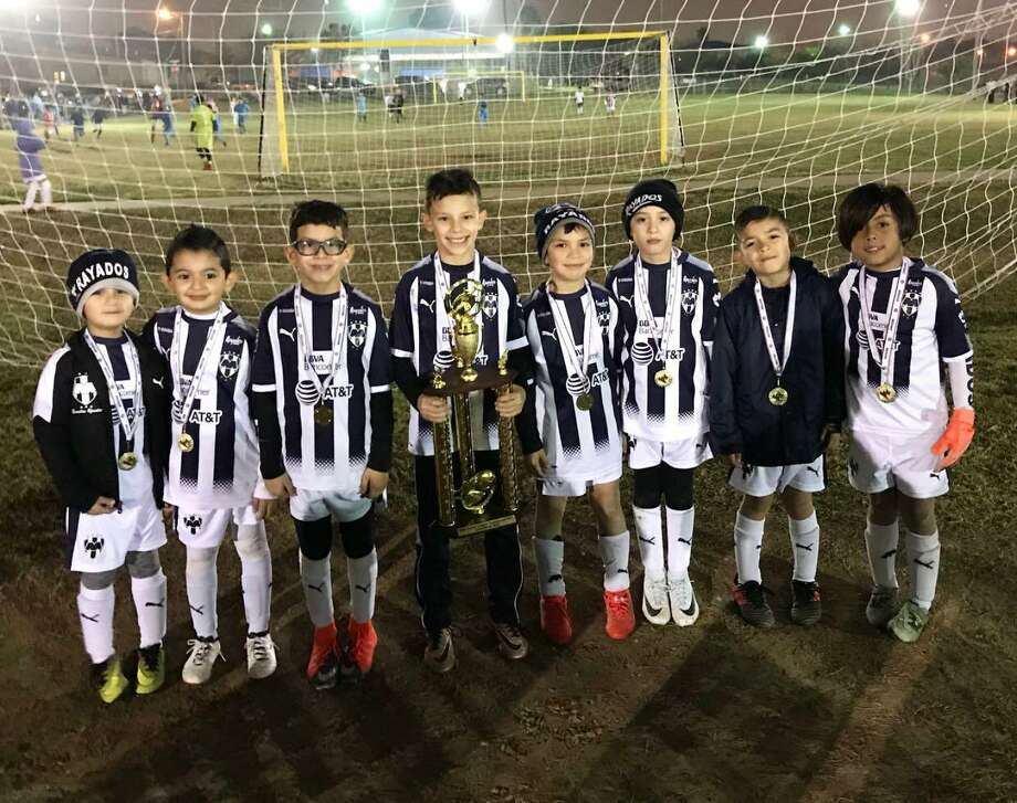 The 2010 Rayados blue team won back-to-back season championships in the 7 Flags Elite soccer league. Pictured from left are Mundo, Damian, Dallas, Mau, Joaquin, Angel Del Bosque, Angel Pruneda and Luis. Photo: Courtesy Photo