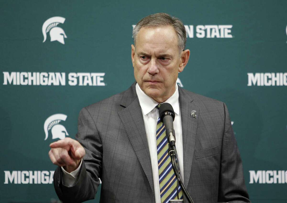Michigan State football coach Mark Dantonio addresses the media about the school's handling of sexual abuse allegations Friday before a basketball game between the Spartans and Wisconsin in East Lansing.