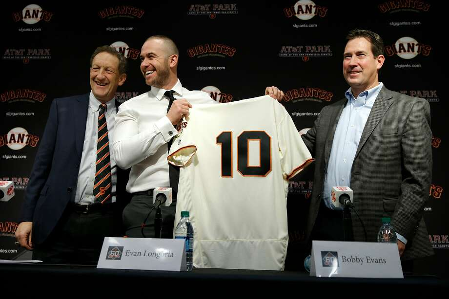 From left: Giants CEO Larry Baer, third baseman Evan Longoria and general manager Bobby Evans. The Giants mostly went the trade route to address their offseason needs. Photo: Santiago Mejia, The Chronicle