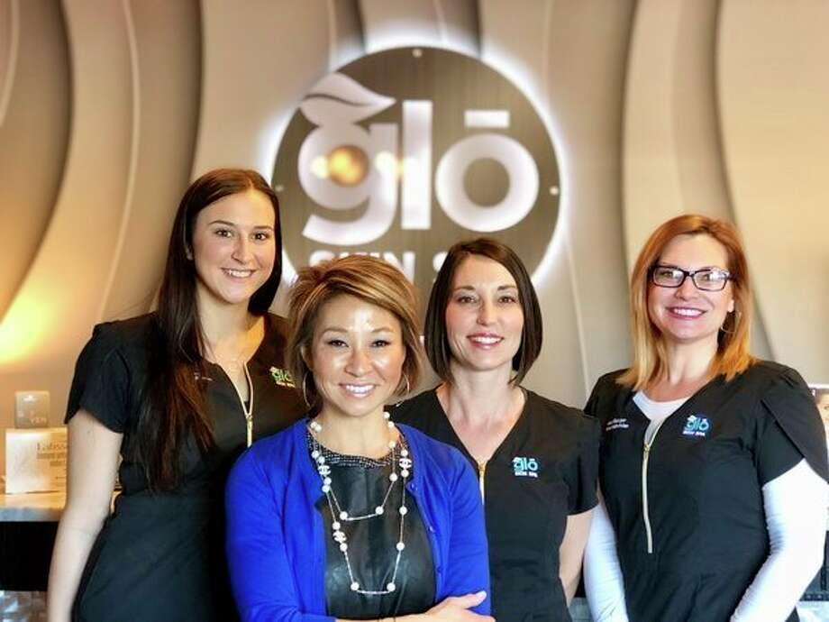 The staff at glo Skin Spa, 6225 N. Jefferson Ave., at the corner of Jefferson and Wackerly Street, are, from left, Jillian Brady, aesthetician; Meko Price, owner; Salena Dodman, aesthetics nurse; and Jennifer Eichinger, aesthetician. (Photo provided)