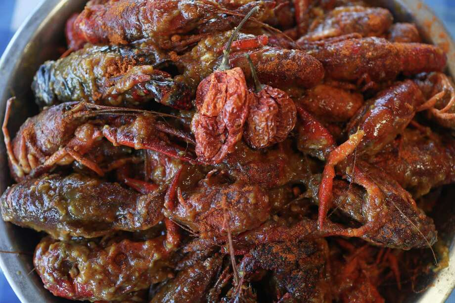 Casian Crawfish has created a Vietnamese-style Cajun crawfish dish coated in Carolina Reaper chile pepper, one of the world's hottest peppers.  Photo: Steve Gonzales, Houston Chronicle / © 2018 Houston Chronicle