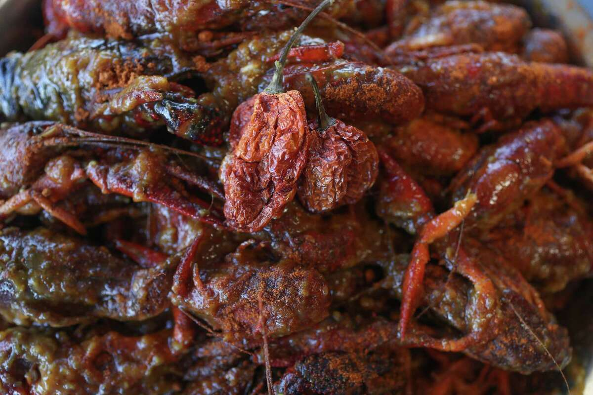 Casian Crawfish has created a Vietnamese-style Cajun crawfish dish coated in Carolina Reaper chile pepper, one of the world's hottest peppers.