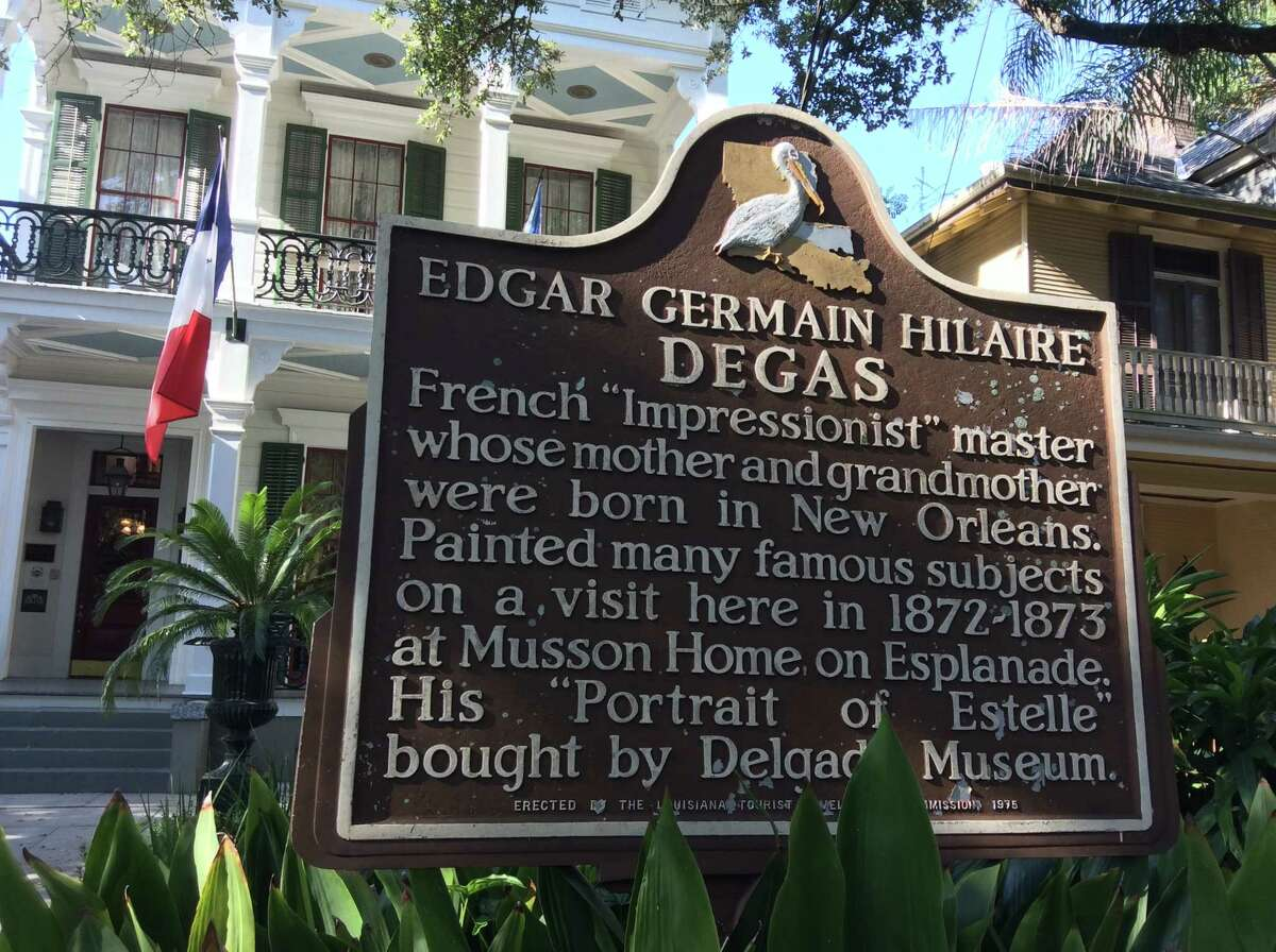 Historic plaque at the Degas Houseon Esplanade in New Orleans
