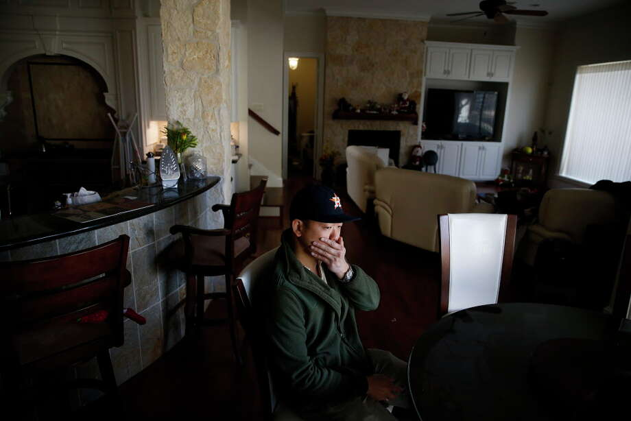 Richard Lam sits at the kitchen table at his parents house Tuesday, Jan. 23, 2018 in Houston. His parents, Bao and Jenny Lam, were found murdered in their home on Dec. 13 after Richard returned from a cruise and couldn't get in contact with them. Three men have been arrested for their murders. Photo: Michael Ciaglo, Houston Chronicle / Michael Ciaglo