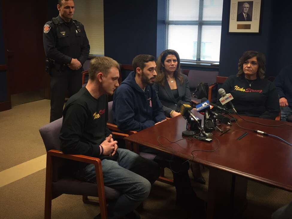 Niko DiNovo's older brother, Michael, second from left, speaks to reporter about the sentencing of Michael Carr, the teen accused of nearly killing Niko DiNovo in a 2016 car crash in Colonie. At left is DiNovo's cousin, Marcus Resciniti. On Michael DiNovo's right is Albany County Assistant District Attorney Mary Tanner-Richter and his aunt, Davina Resciniti.