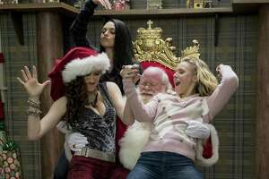 """Kathryn Hahn, Mila Kunis and Kristen Bell make merry with Santa in """"A Bad Moms Christmas."""""""