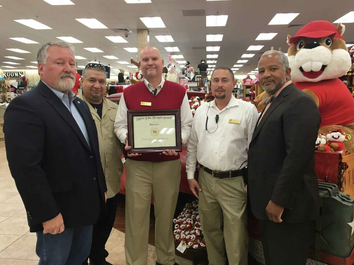 Buc-ee's of Katy receivedthe Spirit of the Trooper Award on Jan. 23 from the American Association of State Troopers (AAST). From left are: Keith Barbier, AAST president; Rick Muniz, AAST member; Brent A. Call, general manager, Buc-ee's general manager; Robert Clark, Buc-ee's maintenance manager; and George Rhyne, AAST member. Buc-ee's was recognized for its support of first responders during Hurricane Harvey.