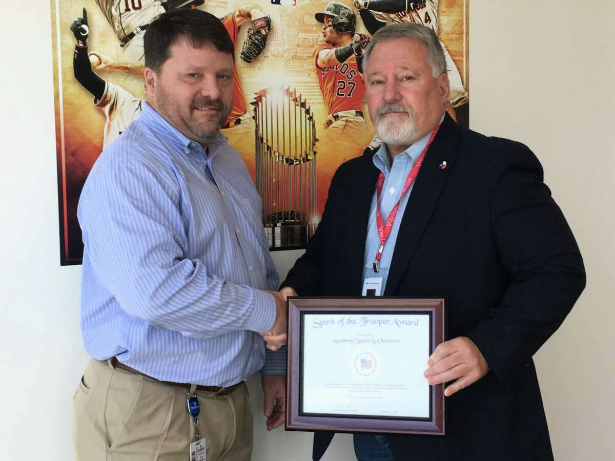 Joe Matthews, vice president of loss prevention ofAcademy Sports & Outdoors, received the Spirit of the Trooper Award from Keith Barbier, president of the American Association of State Troopers Inc.on Jan. 23 for the company's support of first responders during Hurricane Harvey.